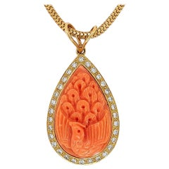 18 Karat Golden Necklace with Carved Coral Pendant and 0.70 Carat Diamonds