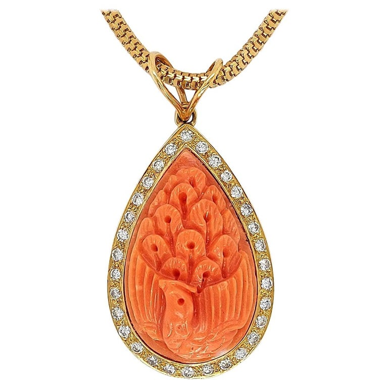 18 Karat Golden Necklace with Carved Coral Pendant and 0.70 Carat Diamonds For Sale