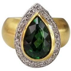 18 Karat Green Tourmaline with Diamond Pave' Halo