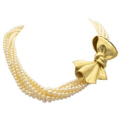 18 Karat Hammered Gold and Pearl Bow Necklace