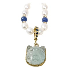 18 Karat Hand Carved Aquamarine Lioness with Sapphire Bail