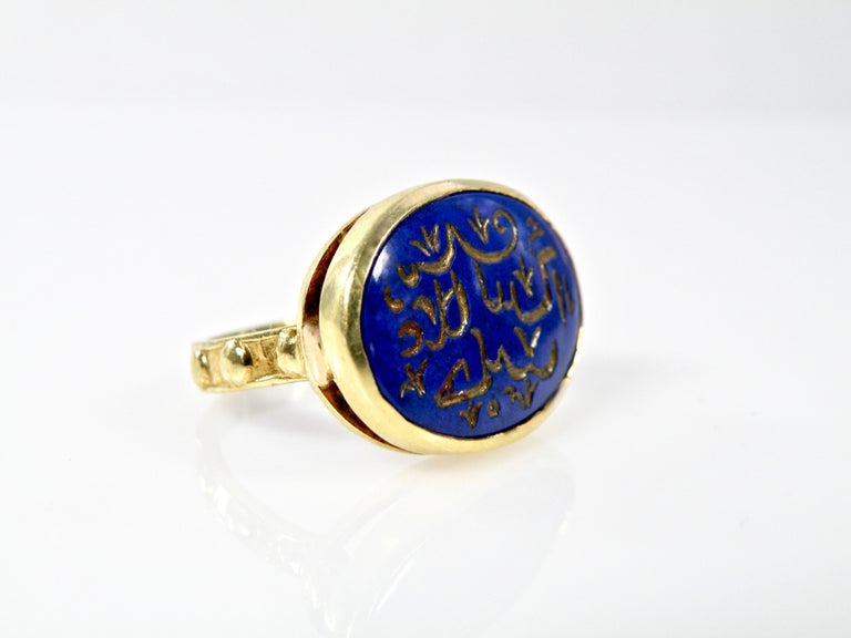 Modern 18 Karat Hand Carved Lapis Lazuli Engraved Gold Prayer Ring For Sale