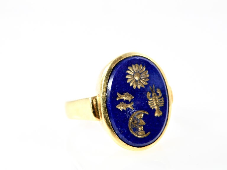 18 Karat Lapis Lazuli Handcarved Ring with inlaid Zodiac Symbols