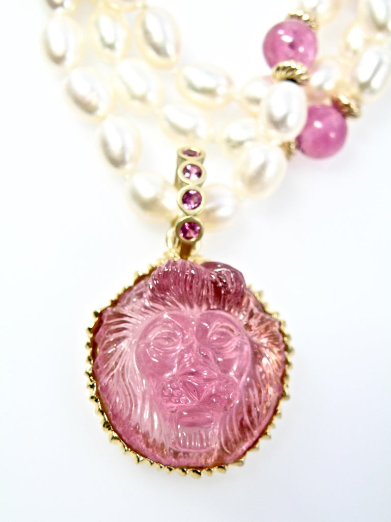 Modern 18 Karat Hand Carved Pink Tourmaline Lionshead with Pink Sapphire Bail For Sale