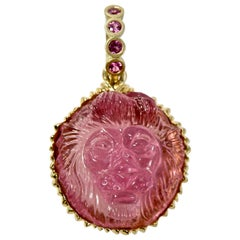 18 Karat Hand Carved Pink Tourmaline Lionshead with Pink Sapphire Bail