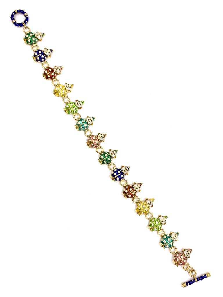 Made by expert enamel fine jewelry designer, HIDALGO. This heavy 18 karat yellow gold toggle clasp bracelet features 14 adorable clown links, each with a hand painted suit and matching hat, colors include: golden yellow, forest green, royal blue,