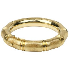 18 Karat Hinged Bangle with Florentine Finish