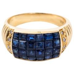 18 Karat Invisible Set Sapphire and Diamond Ring