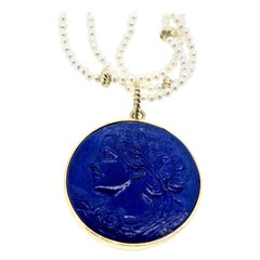 18 karat Lapis Lazuli and Sapphire Lady with City Carving