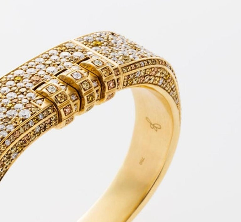 This Made to Order 18 Karat Pave Code Bracelet features a thick solid 18k yellow gold band with your choice of pave precious stones, and a customizable code that opens and locks the bracelet onto the wearer's wrist.  Lock Combination can be