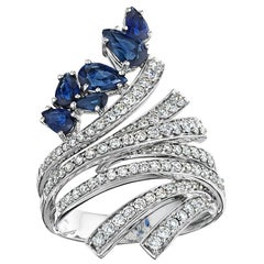 18 Karat Mirage White Gold Ring with Diamonds and Blue Sapphire