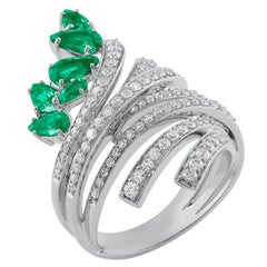 18 Karat Mirage White Gold Ring with Vs Gh Diamonds and Green Emerald