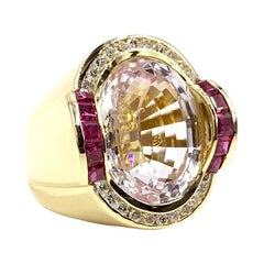 18 Karat Modern Oval Kunzite, Ruby and Diamond Cocktail Ring