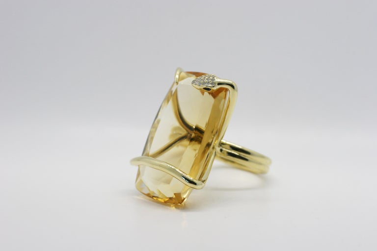 18k Yellow Gold Citrine Climbing Snake Ring features Perez Bitan's signature curved snake with blue sapphire eyes and white diamond micro pave head that wraps around the finger and sets the cushion cut large natural citrine in place  18k Yellow