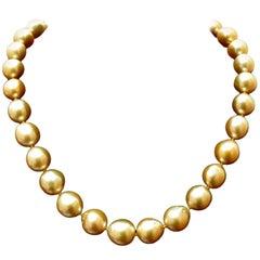 18 Karat Natural South Sea Yellow Pearls Necklace .50 Carat Diamond Clasp