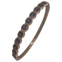 18 Karat Oval Sapphires and Diamonds Bangle Bracelet