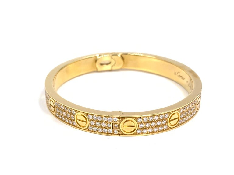 18 Karat Yellow Gold Cartier Love Bracelet with Pave Diamonds In Good Condition For Sale In Pikesville, MD