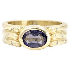 18 Karat Purple Iolite and Diamond Ring