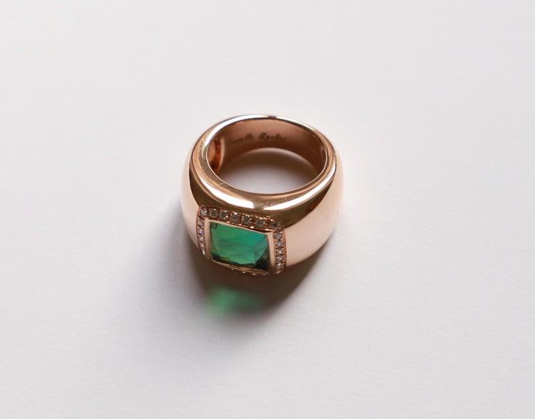 18 Karat Rose Gold 5 Karat Tourmaline 0.28 Karat White Diamond Design Ring A deep green 5 karat tourmaline stone embedded in a beautiful 18 karats rose gold design ring adorned with enchanting 0.28 karat white diamonds.  This ring is entirely