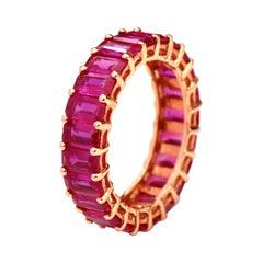 18 Karat Rose Gold 5.63 Carat Ruby Emerald-Cut Full Band Ring