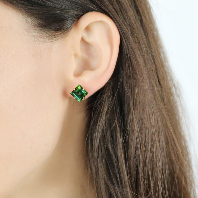 One of a kind emerald cut green tourmaline studs set in 18kt rose gold.  Sparkling, bright and lightweight, this pair of 18kt rose gold studs are meant for everyday use as an unexpected alternative to a classic pair of diamond studs.  The