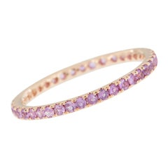 18 Karat Rose Gold and Pink Sapphire Eternity Ring