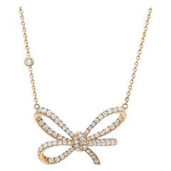 18 Karat Rose Gold and White Diamonds Bow Pendant