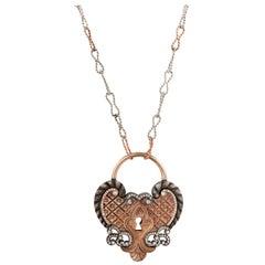 18 Karat Rose Gold Antique Padlock Necklace with 0.66 Carat White Diamonds