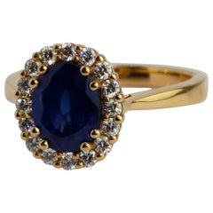 18 Karat Rose Gold Blue Sapphire Diamond Engagement Ring