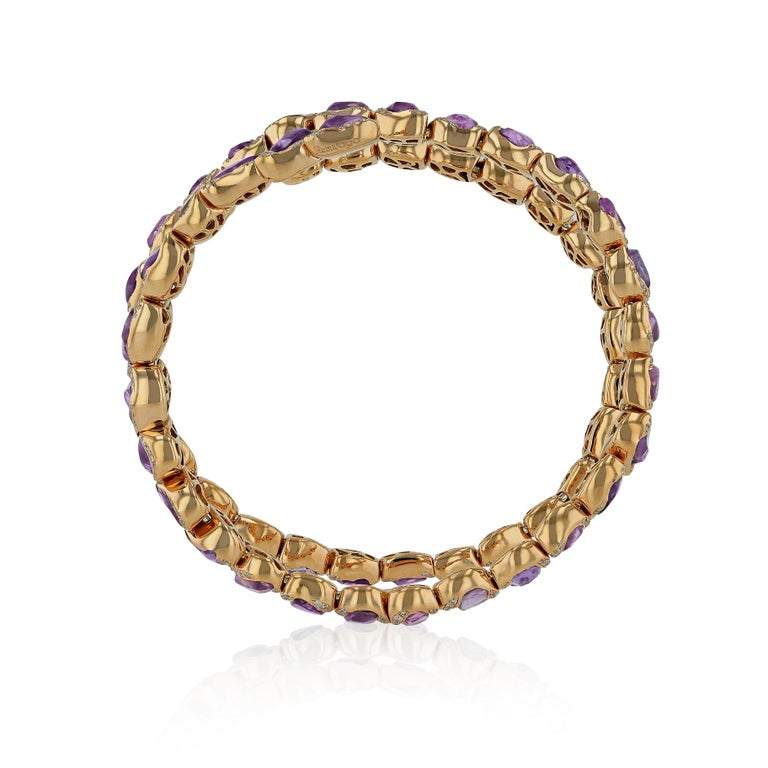 For the love of details, this bracelet is made in a very artistic way adorned by organic pink sapphires and diamonds. It combines between classical and contemporary style with its vibrant color and the natural beauty of the precious gemstones. Worn