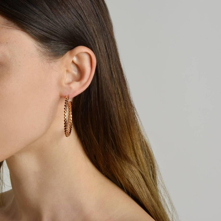 High polish 18kt rose gold Brillante® hoop earrings, grande.   Translated from a quintessential Venetian motif, the Brillante® jewelry collection combines strong jewelry design, cutting edge technology and fine engineering.    A bracelet from this
