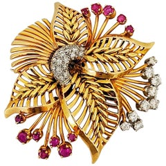 18 Karat Rose Gold Brooch with Diamonds and Rubies, circa 1940s