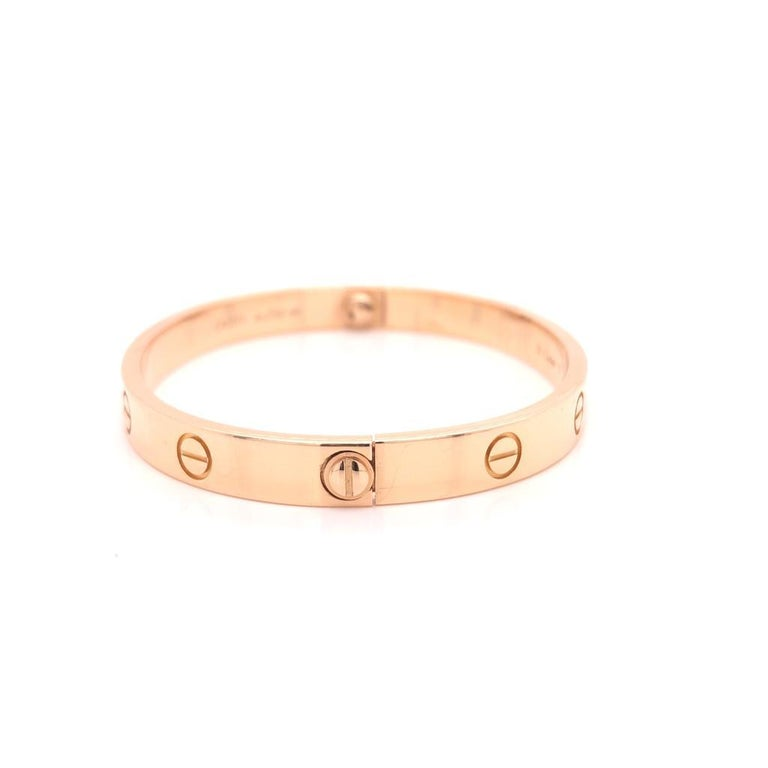18 Karat Rose Gold Cartier Love Bracelet  Bangle  Size: 17  Reference number: B6035617 Comes with a screwdriver. Width: 6.1mm. Box and Papers  Comes with CERTIFICATE  About the collection: A child of 1970s New York, the LOVE collection remains today