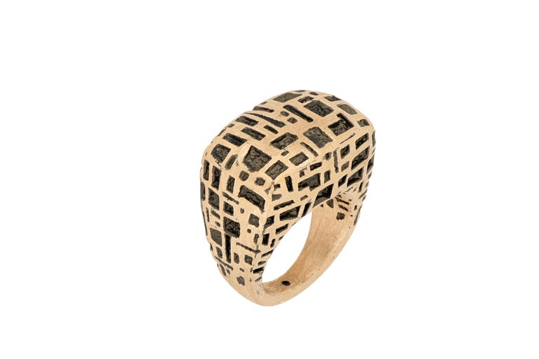 18 karat rose gold cocktail ring, designed in Italy. The ring is beautifully made with bold and interesting pattern, very stylish with square shank. The brand  is renowned for its high jewellery collections with fabulous designs. Our designs reflect