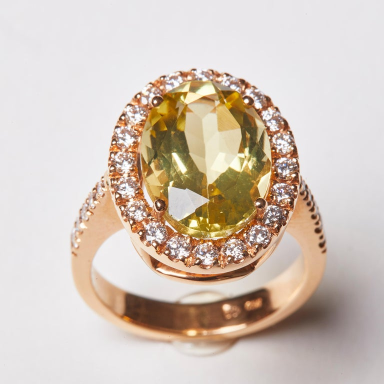 This stunning 18 Karat Rosé Gold Cocktail Ring features a beautiful oval cut citrine center stone, haloed by diamonds.    30 Diamonds 0.73 Carat HSI 1 Citrine 6.20 Carat  Size EU 53 US 6.4   Founded in 1974, Gianni Lazzaro is a family-owned jewelery