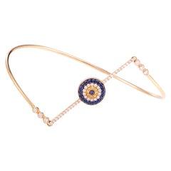 18 Karat Rose Gold Diamond Blue and Yellow Sapphire Evil Eye Bangle Bracelet