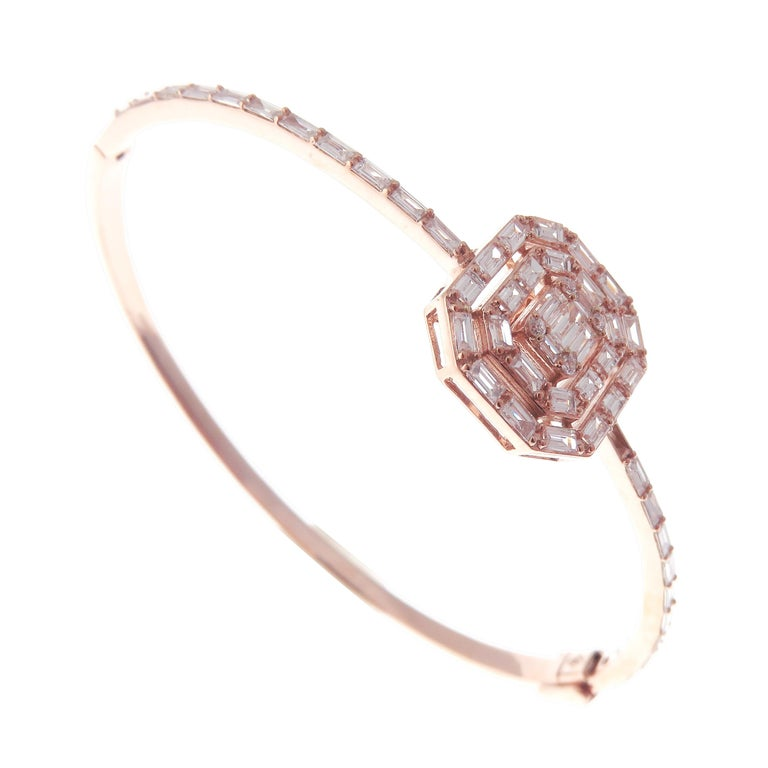 This delicate square baguette bangle is crafted in 18-karat rose gold, weighing approximately 1.62 total carats of V-Quality white diamond. Side clasp closure.    Fits wrists up to 6.75