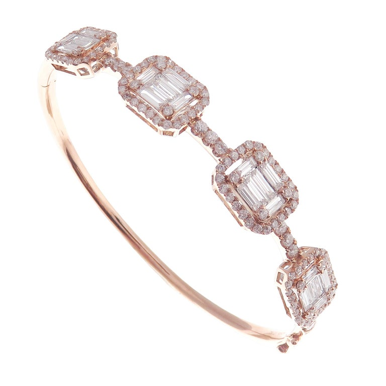 This delicate baguette squares bangle is crafted in 18-karat rose gold, weighing approximately 2.79 total carats of V-Quality white diamond.   Fits wrists up to 6.25