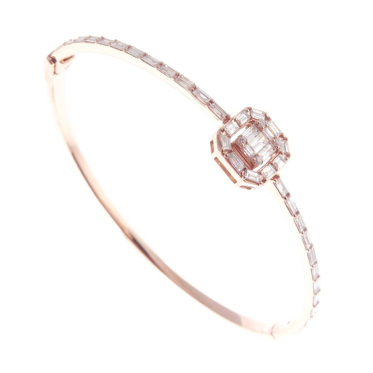 This delicate square baguette bangle is crafted in 18-karat rose gold, weighing approximately 1.35 total carats of V-Quality white diamond. Side clasp closure.    Fits wrists up to 6.75