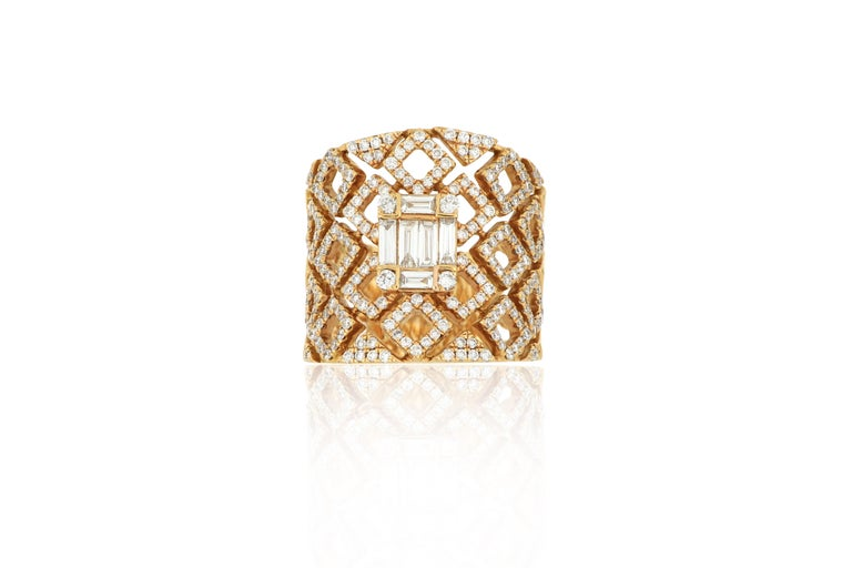 A diamond ring, composed of baguette diamonds and brilliant-cut diamonds, weighing approximately 1.23 carats in total, mounted in 18K rose gold. O'Che 1867 was founded one and a half centuries ago in Macau. The brand is renowned for its high