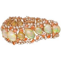 18 Karat Rose Gold Ethiopian Opal, Coral Strand Bracelet with Diamond