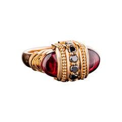 18 Karat Rose Gold Garnet and Black Diamond Ring