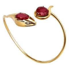 18 Karat Rose Gold, Garnets and Diamonds Snake Bracelet