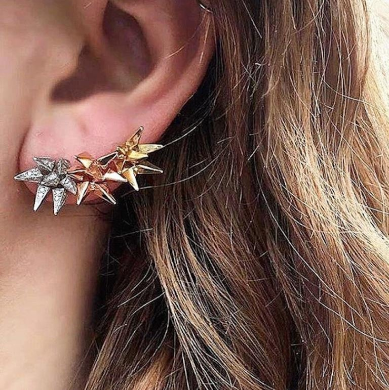 18k Rose Gold Geometric Hedgehog Studs feature Karma El Khalil's signature spike edge geometric shape stud set in 18k Rose Gold  18k Rose Gold Includes 18k Rose Gold push closure earring backings  Sold as a Pair  From Karma El Khalil's Classics