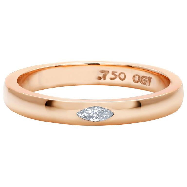 Eighteen karat rose gold ring Marquise diamond weighing 0.10 carat                                                                      Ring size 6 In Stock Ring can be resized  Bandwidth 2.75 millimeter Semi Matt finish  New Ring Handmade in