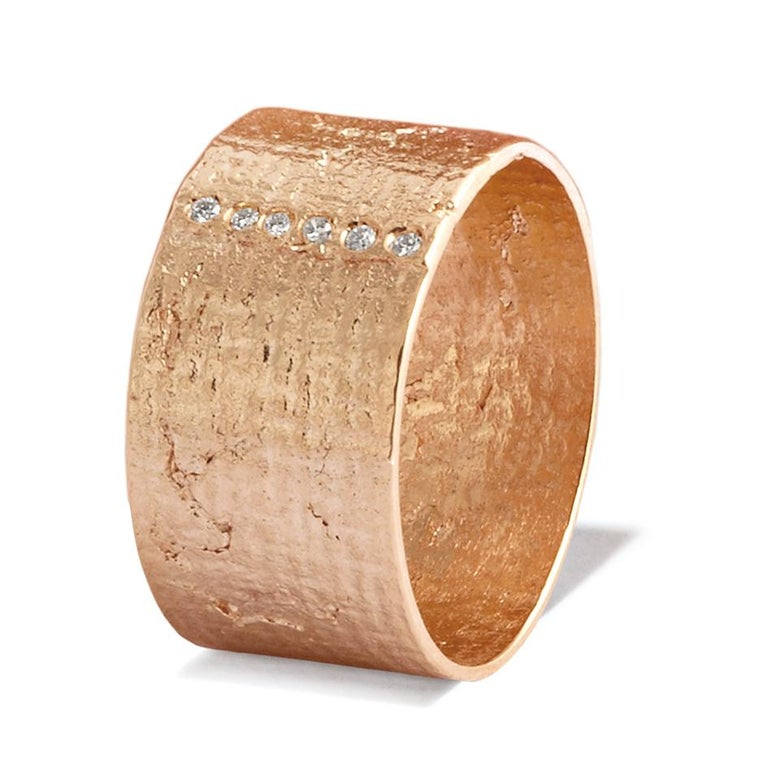 This classic textured wide cigar band ring crafted in solid 18-carat rose gold has a unique shimmering texture accented with six white diamonds. Diamonds are 1.2mm in diameter, H colour VS1 clarity with an approximate total carat weight of 0.05