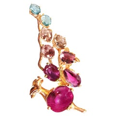 18 Karat Rose Gold Pendant Necklace with Rubies, Red Sapphire and Malaya Garnets