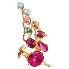 18 Karat Rose Gold Pendant Necklace with Rubies, Sapphires and Malaya Garnets