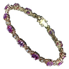 "18 Karat Rose Gold Pink Sapphire and Diamond ""x"" Tennis Bracelet"