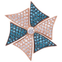 18 Karat Rose Gold Ring with Brilliant Cut White and Blue Diamonds